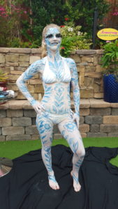 Live Body painting for San Diego FOX 5 Morning News by bodypainter Lana Chromium
